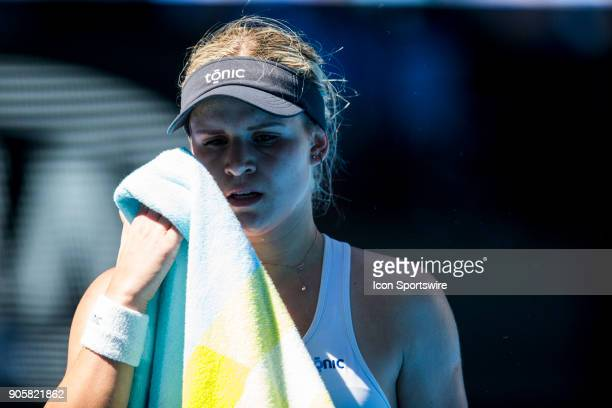 Jana Fett of Croatia swipes sweat of her face in her Second Round match during the 2018 Australian Open on January 17 at Melbourne Park Tennis Centre...