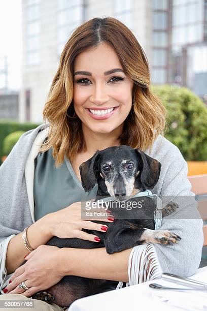 Jana Ina Zarrella supports the 'We Are Better With Pets' campaign with her dog Tyson on April 05, 2016 in Cologne, Germany.