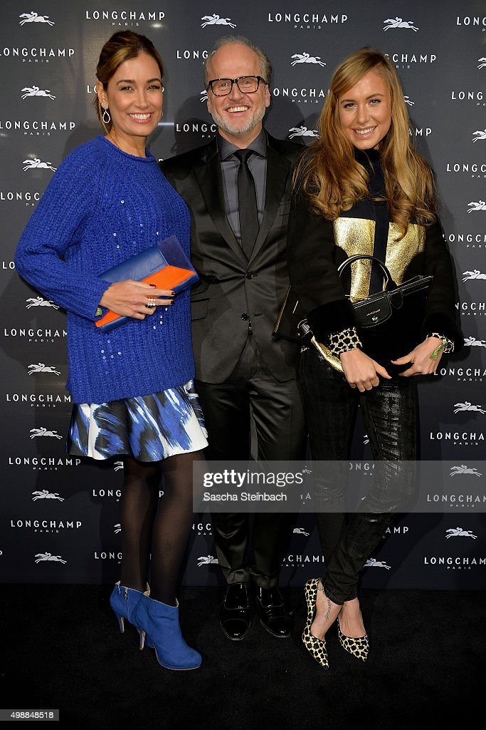 Jana Ina Zerella, Markus Wahl of Longchamp and Alina Gerber attend the Longchamp store opening on November 26, 2015 in Cologne, Germany.