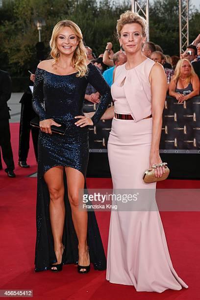 Jana Julie Kilka and Eva Habermann attend the red carpet of the Deutscher Fernsehpreis 2014 on October 02 2014 in Cologne Germany