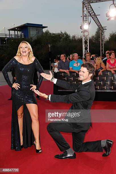 Jana Julie Kilka and Thore Schoelermann attend the red carpet of the Deutscher Fernsehpreis 2014 on October 02 2014 in Cologne Germany