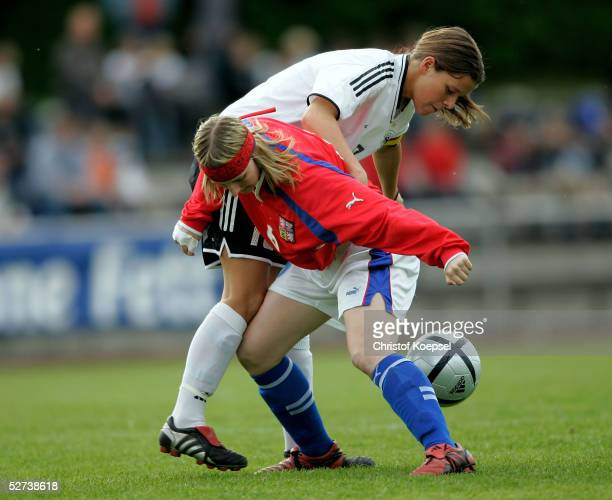 Jana Kralowa of Czech Republic tackles Patricia Hanebeck of Germany during the Women's Under 19 European Championships qualification match between...