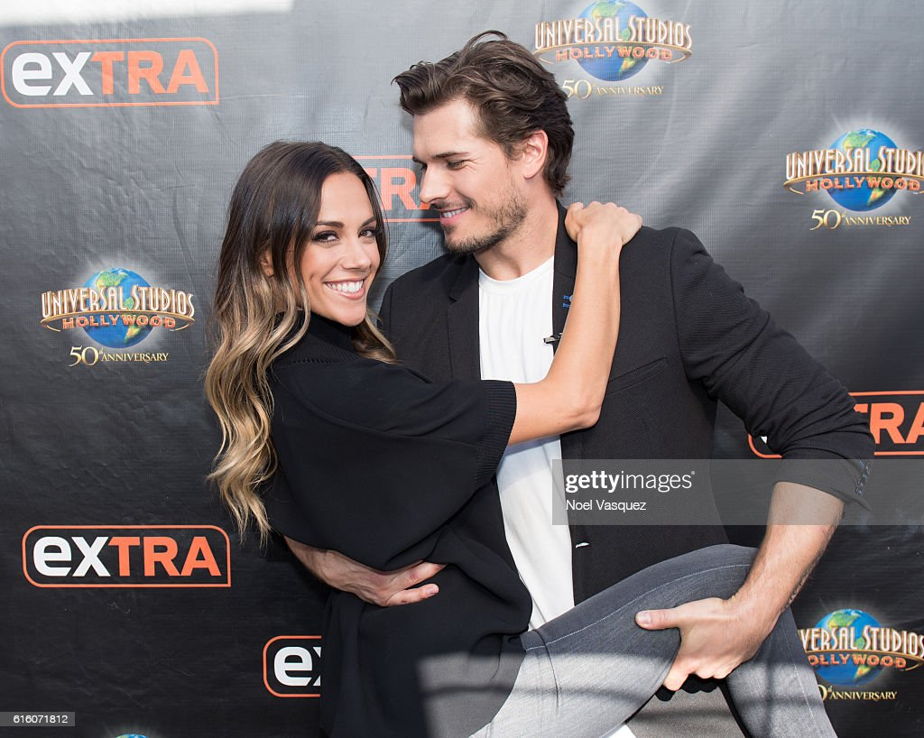 Jana Kramer (L) and Gleb Savchenko visit 'Extra' at Universal Studios Hollywood on October 21, 2016 in Universal City, California.