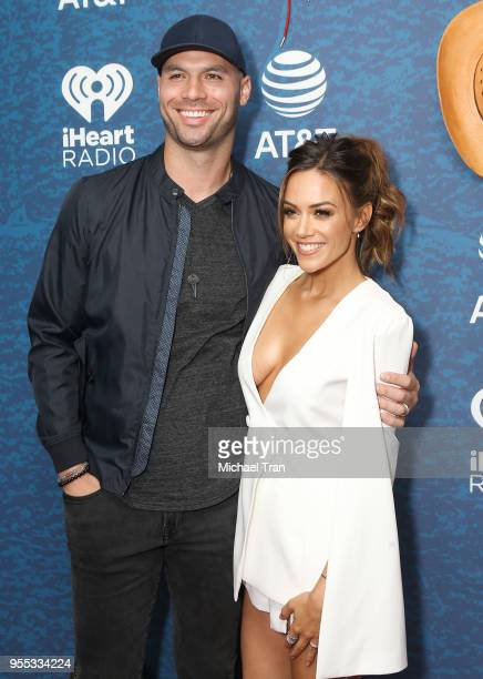 Jana Kramer and Mike Caussin attend the 2018 iHeartCountry Festival by ATT held at The Frank Erwin Center on May 5 2018 in Austin Texas