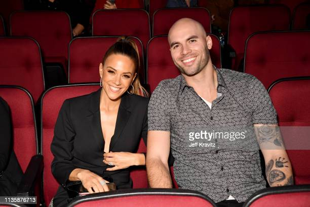 Jana Kramer and Mike Caussin attend the 2019 iHeartRadio Music Awards which broadcasted live on FOX at the Microsoft Theater on March 14 2019 in Los...