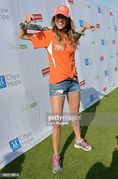 Jana Kramer attends the City of Hope Celebrity Softball Game during the CMA Festival at Greer Stadium on June 7 2014 in Nashville Tennessee