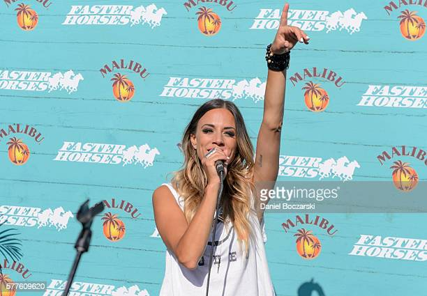Jana Kramer surprises guests with a popup acoustic performance and 'Because Summer' moment at the Malibu® Rum Beach House at Faster Horses Festival...