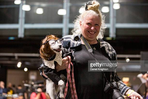 Jana Lee St. Claire and her dog Iggy Boo appear in cosplay as Judge Judy at Comic-Con Museum on July 07, 2019 in San Diego, California.