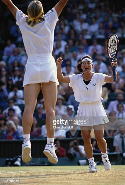 Jana Novotna jumps in the air to celebrate with Arantxa Sanchez Vicario after their Women's Doubles final match victory against Gigi Fernandez and...