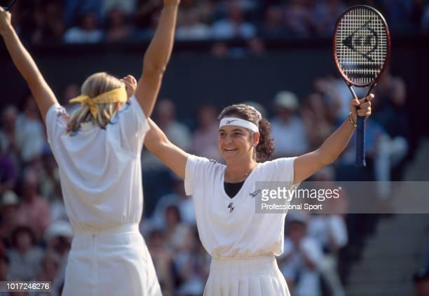 Jana Novotna of Czech Republic and Arantxa Sanchez Vicario of Spain celebrate after defeating Gigi Fernandez of the USA and Natasha Zvereva of...