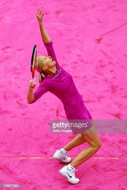 Jana Novotna of Czech Republic plays on a pink clay court with partner Martina Navratilova of USA in the women's legends doubles semi final match...