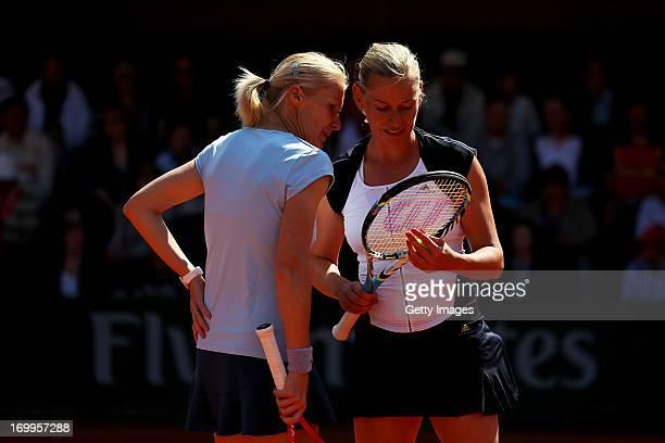 Jana Novotna of Czech Repulic and Barbara Schett of Austria talk tactics during their women's legends match against Lindsay Davenport of United...