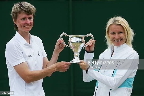Jana Novotna of the Czech Republic and Helena Sukova of the Czech Republic pose with the winners trophy following the Women's Invitation Doubles...