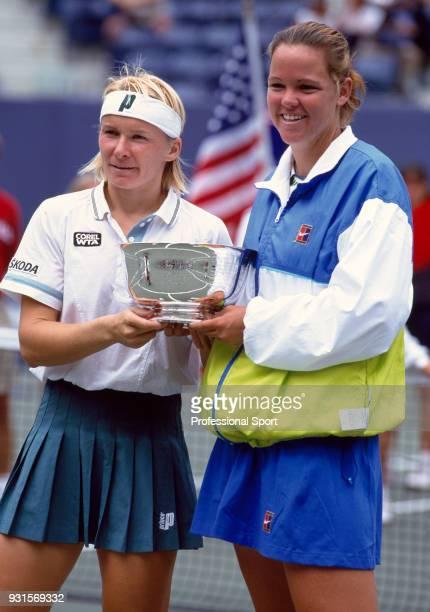 Jana Novotna of the Czech Republic and Lindsay Davenport of the USA pose with the trophy after defeating Gigi Fernandez of the USA and Natasha...