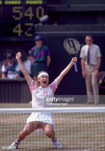 Jana Novotna of the Czech Republic celebrates after defeating Martina Navratilova of the USA in the Women's Semi-Final of the Wimbledon Lawn Tennis...