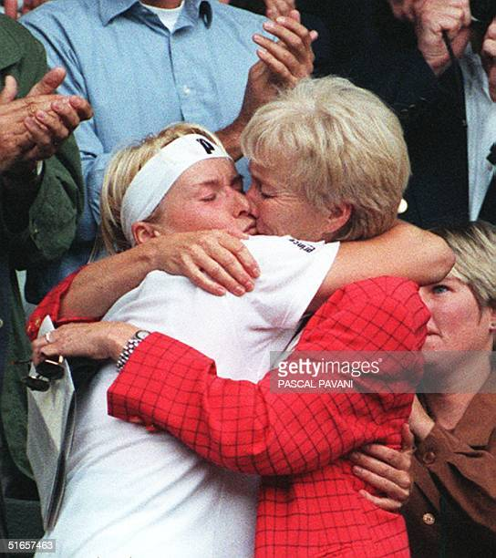 Jana Novotna of the Czech Republic embraces and kisses her mother Livuse Novotna after clinching the women's singles title with a 64 76 victory over...