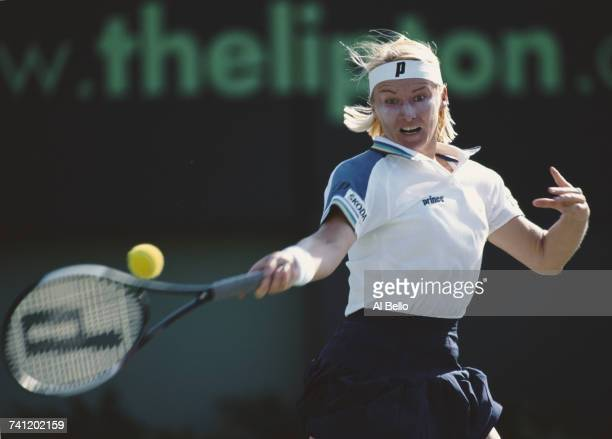 Jana Novotna of the Czech Republic eyes the ball for a forehand return against Venus Williams during their Women's Singles Quarter Final match at the...