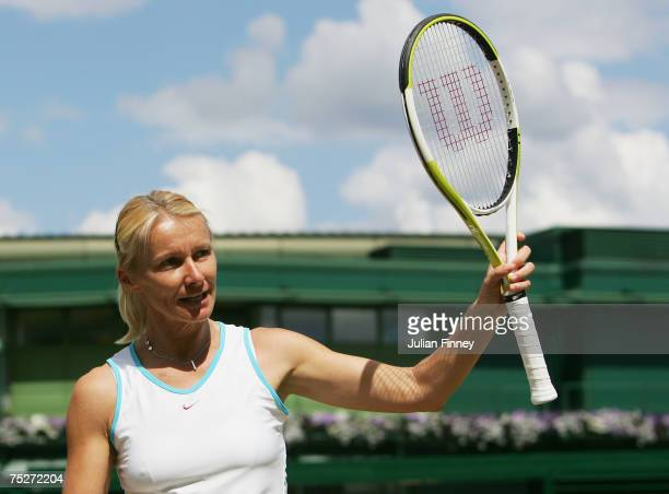 Jana Novotna of the Czech Republic salutes the crowd celebrates victory following the Women's Invitation Doubles Final match against Ilana Kloss of...