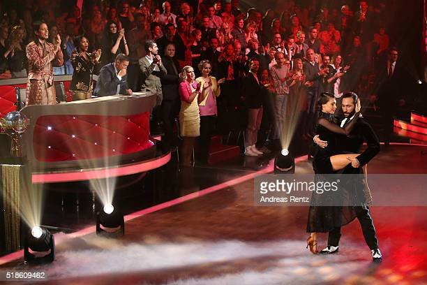 Jana Pallaske and Massimo Sinato perform on stage during the 3rd show of the television competition 'Let's Dance' on April 1 2016 in Cologne Germany