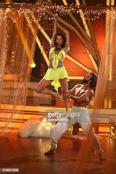 Jana Pallaske and Massimo Sinato perform on stage during the 8th show of the television competition 'Let's Dance' on May 6 2016 in Cologne Germany