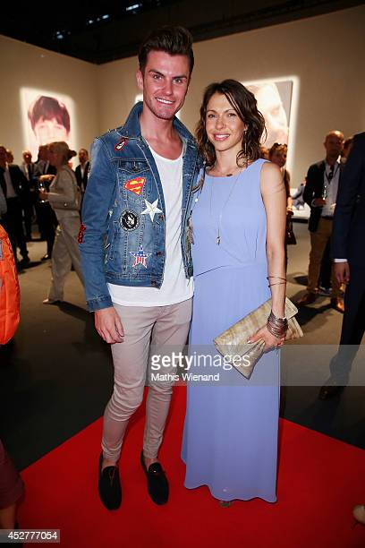 Jana Pallaske and PaulHenry Duval attend the SOliver Collection Presentation on July 26 2014 in Duesseldorf Germany