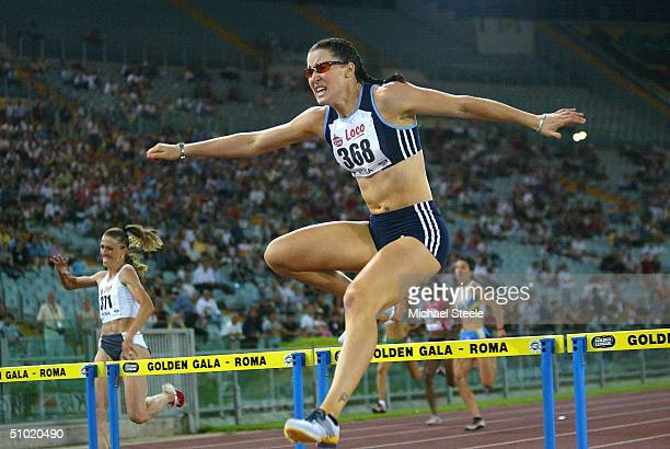 Jana Pittman of Australia clears the last hurdle on her way to winning the women's 400m hurdles race at the IAAF Golden Gala meet at the Stadio...