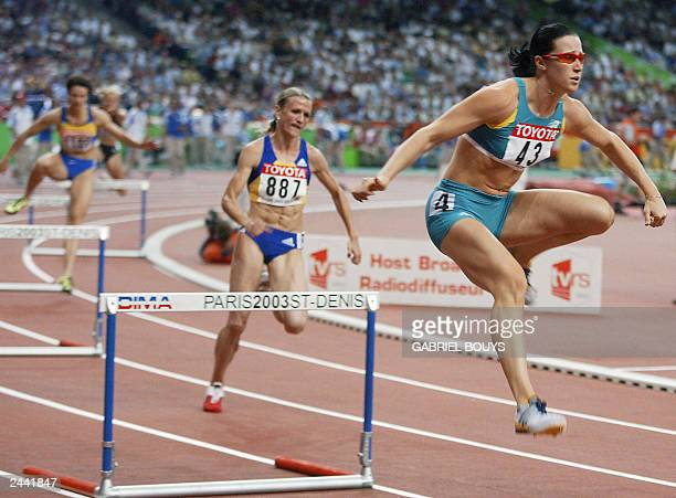 Jana Pittman of Australia jumps a hurdle in the women's 400m hurdles final ahead of Ionela Tirlea of Romania 28 August 2003 during the 9th Athletics...