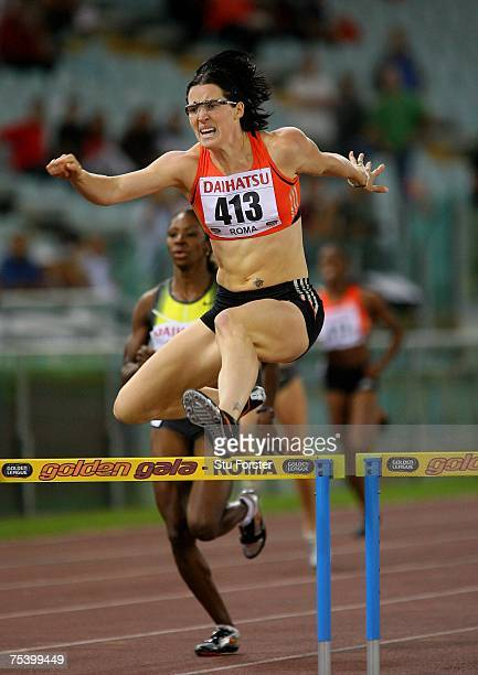 Jana Rawlinson of Australia clears the last hurdle on her way to winning the Womens 400 metres Hurdles during the IAAF Golden Gala at The Olympic...