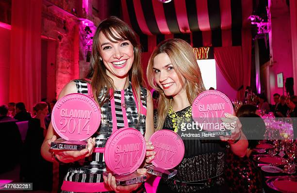 Jana Sazepin and Isabelle Schleemilch pose with their awards during the Glammy Award by Glamour Magazine on March 6, 2014 in Munich, Germany.