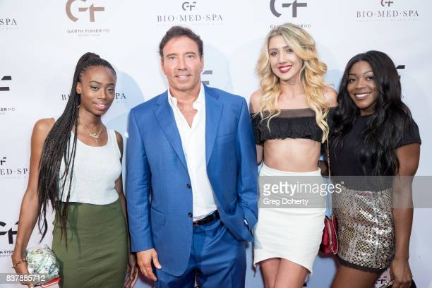 Janae Robinson Dr Garth Fisher Ashley Ethridge and Samantha Robinson attend the Official Launch Party Of Dr Garth Fisher's BioMed Spa at Garth Fisher...