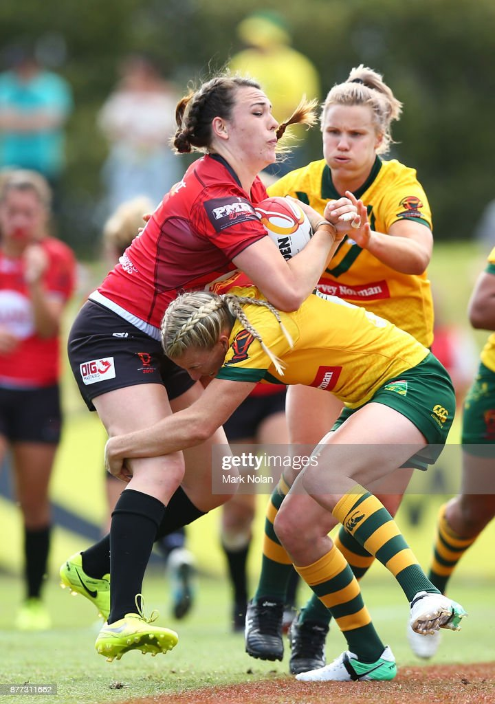 Janai Haupapa of Canada is tackled during the Women's Rugby League World Cup match between the Canadian Ravens and the Australian Jillaroos at Southern Cross Group Stadium on November 22, 2017 in Sydney, Australia.