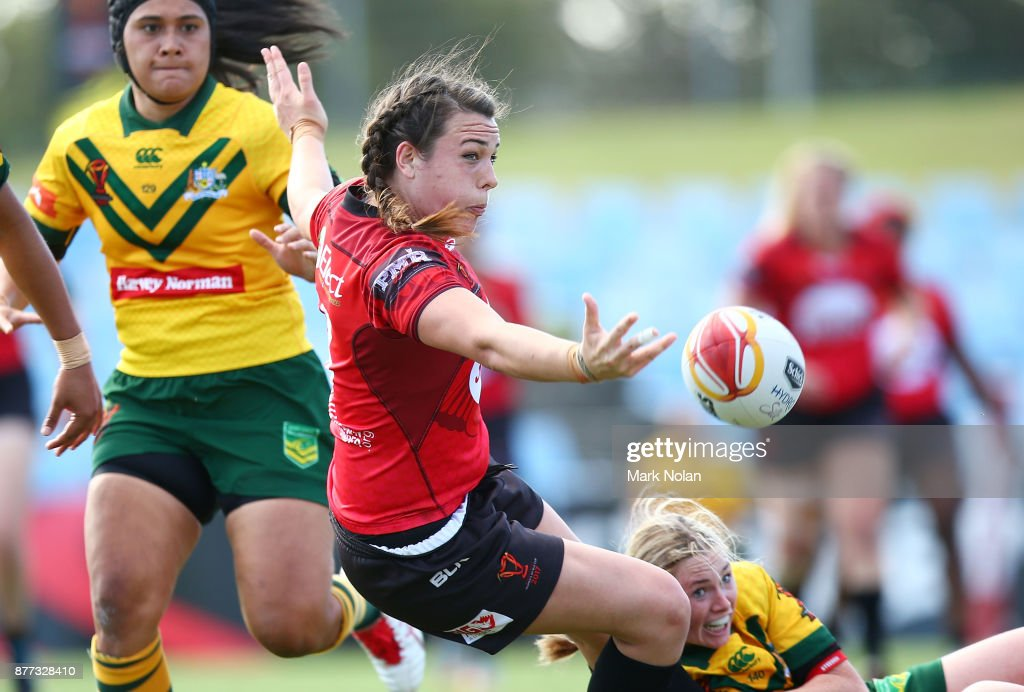 Janai Haupapa of Canada offloads during the Women's Rugby League World Cup match between the Canadian Ravens and the Australian Jillaroos at Southern Cross Group Stadium on November 22, 2017 in Sydney, Australia.