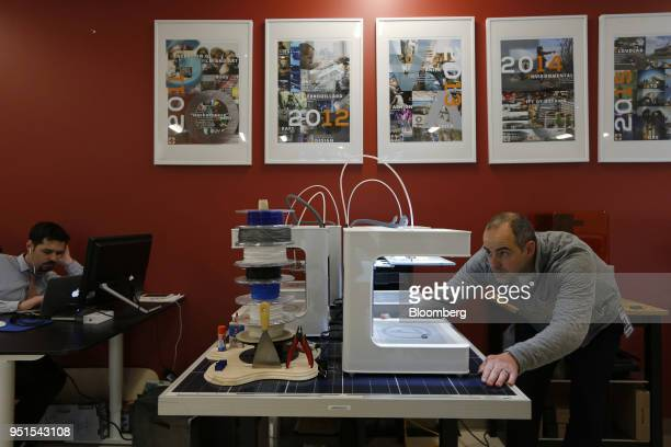 Janak Alford chief executive officer of prototypeD TEAM Inc inspects a 3D printer at the Bayview Yards innovation center in Ottawa Ontario Canada on...