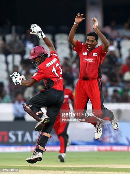 Janaka Gunaratne of Ruhuna Eleven celebrates with wicketkeeper Dinesh Chandimal of Trinidad Tobago after claiming the wicket of batsman Adrian Barath...