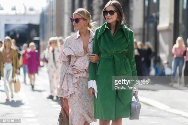 Janaka Polliani and Darja Barannik wearing Balenciaga bag green coat Balenciaga sock boots outside Moods of Norway on August 22 2017 in Oslo Norway