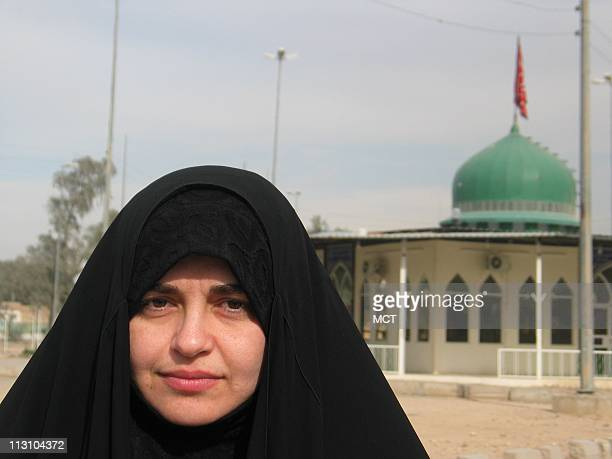 Janan al Ubaidi a candidate on the leading ticket in the Jan 30 elections stands near a mosque after a political rally in the southern Shiite Muslim...