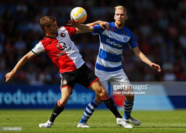 JanArie van der Heijden of Feyenoord battles for the ball with Stef Nijland of De Graafschap during the Eredivisie match between De Graafschap and...