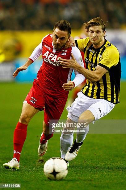 JanArie Van Der Heijden of Vitesse and Muamer Tankovic of AZ battle for the ball during the Dutch Eredivisie match between Vitesse Arnhem and AZ...