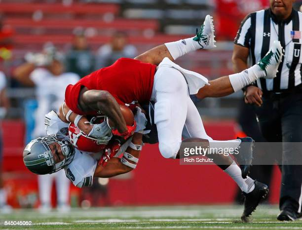 Janarion Grant of the Rutgers Scarlet Knights is tackled by Justin Moody of the Eastern Michigan Eagles during the fourth quarter of a game on...