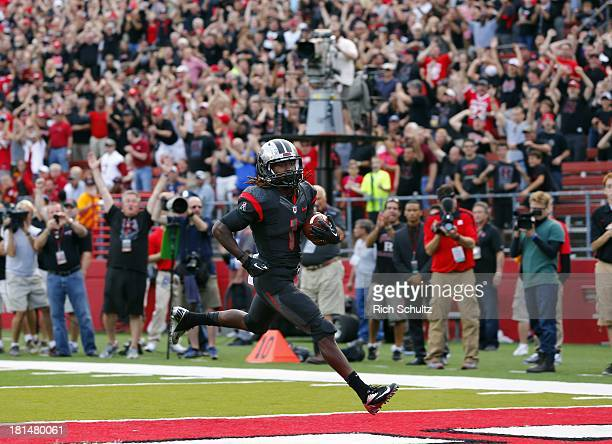 Janarion Grant of the Rutgers Scarlet Knights scores a touchdown on a 58yard punt return against the Arkansas Razorbacks during the third quarter in...
