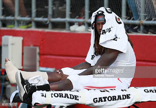 Janarion Grant of the Rutgers Scarlet Knights watches from the sidelines after getting injured against the Iowa Hawkeyes at High Point Solutions...