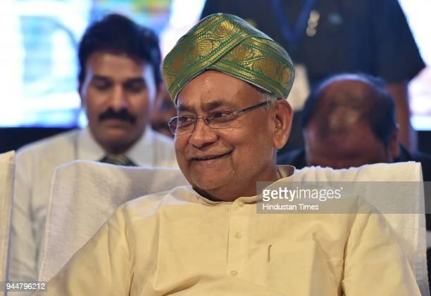 Janata Dal National President and Bihar Chief Minister Nitish Kumar was seen wearing Karnataka's traditional head gear during Karnataka JD workers...
