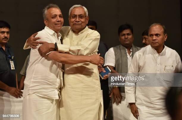Janata Dal National President and Bihar Chief Minister Nitish Kumar embraces JD Karnataka state president Mahima Patel as Ramchandra Prasad Singh JD...