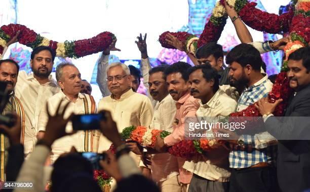 Janata Dal workers greet JD National President and chief minister of Bihar Nitish Kumar during Karnataka JD workers meet at Chowdiah Memorial Hall...