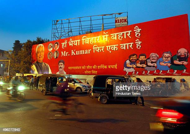 Janata DalUnited leader Nitish Kumar's poster on the street after landslide victory in Bihar assembly elections on November 8 2015 in Patna India...