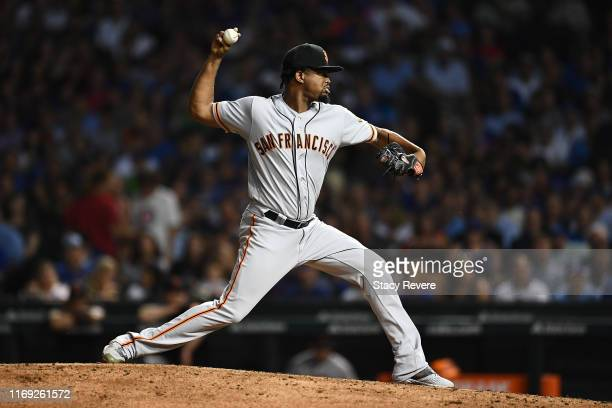 Jandel Gustave of the San Francisco Giants throws a pitch during the sixth inning against the Chicago Cubs at Wrigley Field on August 20 2019 in...