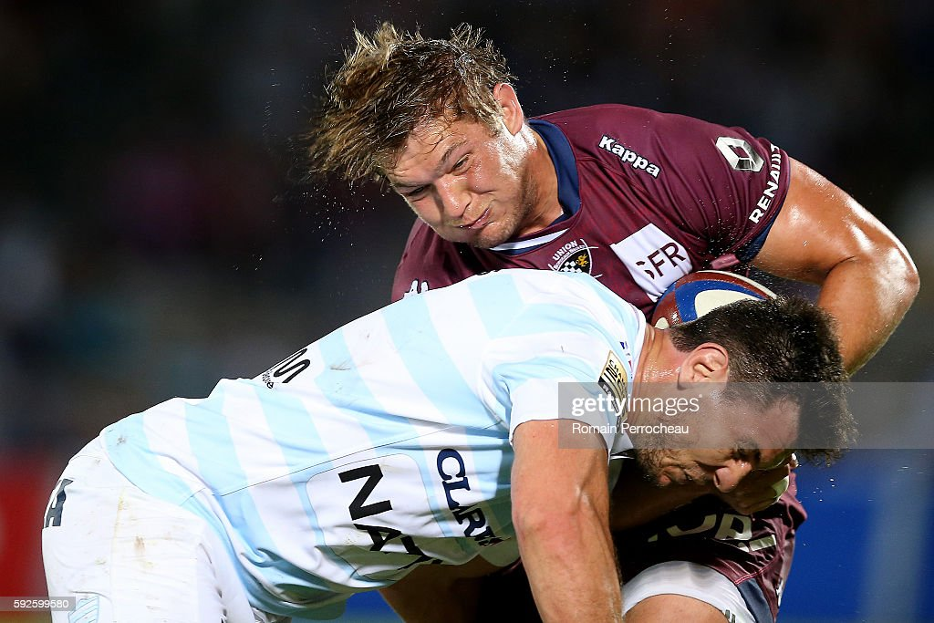 Jandre Marais of Union Bordeaux Begles is tackled by Manuel Carizza (L) of Racing 92 during the French Top 14 union match between Union Bordeaux Begles and Racing 92 at Stade Chaban-Delmas on August 20, 2016 in Bordeaux, France.