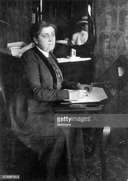 Jane Addams American social reformer and pacifist works at a desk