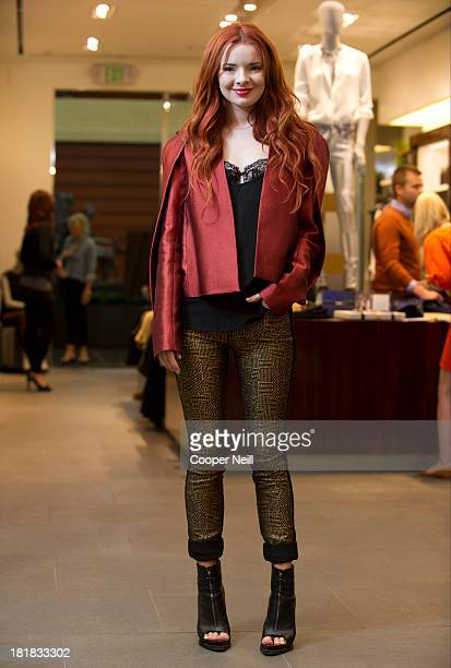 Jane Aldridge poses at 7 For All Mankind in the NorthPark Center during the Malhia Kent premier on September 25 2013 in Dallas Texas
