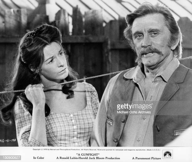Jane Alexander looking at Kirk Douglas in a scene from the film 'A Gunfight' 1971